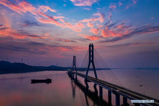 Aerial photo taken on June 28, 2019 shows the Poyang Lake No. 2 Bridge in east China's Jiangxi Province. The 5.589-km Poyang Lake No. 2 Bridge, which links Duobao Township of Duchang County and Hualin Township of Lushan City in Jiangxi Province, opened to the public traffic on Friday. (Xinhua/Fu Jianbin)