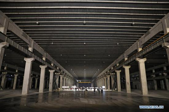 Photo taken on June 25, 2019 shows the underground factory of Dalian Gona Technology Group Co., Ltd. in Dalian, northeast China's Liaoning Province. The 2019 Summer Davos Forum is held from July 1-3 in northeast China's coastal city of Dalian. Established by the World Economic Forum in 2007, the forum is held annually in China, alternating between the two port cities of Dalian and Tianjin. Summer Davos helped Dalian reshape the landscape of regional economy and strengthen the port's trade with other markets. Dalian has become an international city and a showpiece of China's reform and opening up. (Xinhua/Yao Jianfeng)