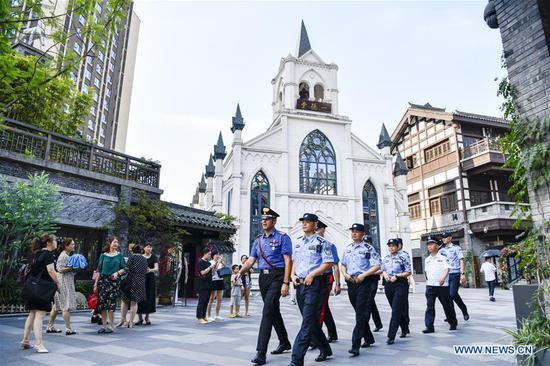 Chinese and Italian police officers patrol at an old street in Nan'an District of southwest China's Chongqing Municipality, July 2, 2019. The police in Chongqing launched a joint patrol with their Italian counterparts on June 26, according to local police. Four Chinese police officers who were fluent in English and Italian joined the patrol with two Italian police officers. Patrolling in popular tourist spots in the municipality, the Italian police officers will help deal with the issues related to Italian tourists during the 10-day joint patrol. The Italian police have sent eight police officers to patrol with Chinese counterparts in four Chinese cities from June 24 to July 5. (Xinhua/Liu Chan)