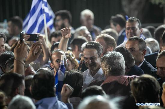 Greek main opposition New Democracy party leader Kyriakos Mitsotakis (C) meets supporters at the conservatives' main pre-electoral rally under the Acropolis hill in Athens, Greece, on July 4, 2019. As Greece's national elections are just around the corner, Kyriakos Mitsotakis, leader of the main opposition New Democracy party, requested on Thursday evening a strong mandate to change Greece. (Xinhua/Lefteris Partsalis)
