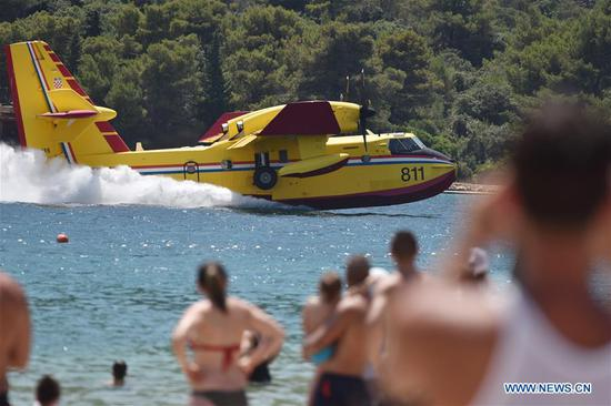 A Canadair fire-fighting plane demonstrates water-taking maneuvers in Grebastica, Croatia, July 4, 2019. (Xinhua/Hrvoje Jelavic)