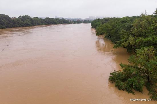 Aerial photo taken on July 8, 2019 shows the flood water of Mishui river in Chaling County, central China's Hunan Province. Heavy rains hit the east of Hunan Province in the past days. (Photo by Chen Sihan/Xinhua)