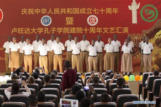 Rwandan students perform a chorus in Chinese at the University of Rwanda in Kigali, capital of Rwanda, on July 10, 2019. Confucius Institute at the University of Rwanda on Wednesday held performances to celebrate the 70th anniversary of the founding of the People's Republic of China and the 10th anniversary of the establishment of the institute. (Xinhua/Gabriel Dusabe)