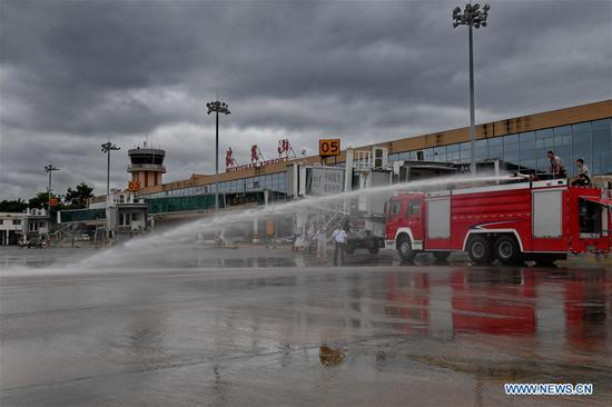 Staff members of Wuyishan Airport clean the tarmac after a flood in Wuyishan City, southeast China's Fujian Province, July 10, 2019. Heavy rains hit Wuyishan City on Tuesday causing surge of water that damaged scenic spots and disrupted power and communications. (Xinhua/Zhang Guojun)