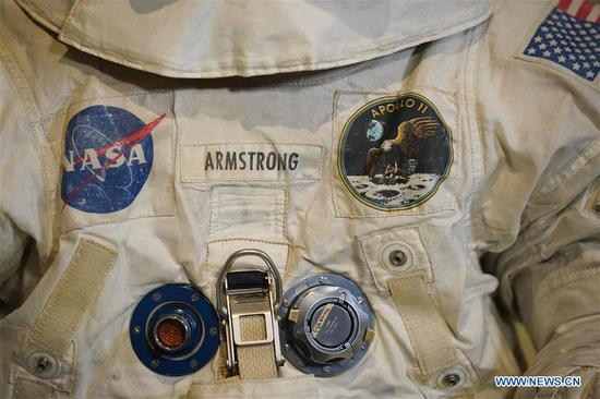 Photo taken on July 16, 2019 shows the details of U.S. astronaut Neil Armstrong's Apollo 11 spacesuit displayed at the Smithsonian National Air and Space Museum in Washington D.C., the United States. The spacesuit is back on display after extensive conservation in celebration of the 50th anniversary of the Apollo 11 Moon landing. (Xinhua/Liu Jie)