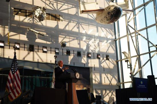 U.S. Vice President Mike Pence speaks at the unveiling ceremony of U.S. astronaut Neil Armstrong's Apollo 11 spacesuit at the Smithsonian National Air and Space Museum in Washington D.C., the United States, July 16, 2019. The spacesuit is back on display after extensive conservation in celebration of the 50th anniversary of the Apollo 11 Moon landing. (Xinhua/Liu Jie)