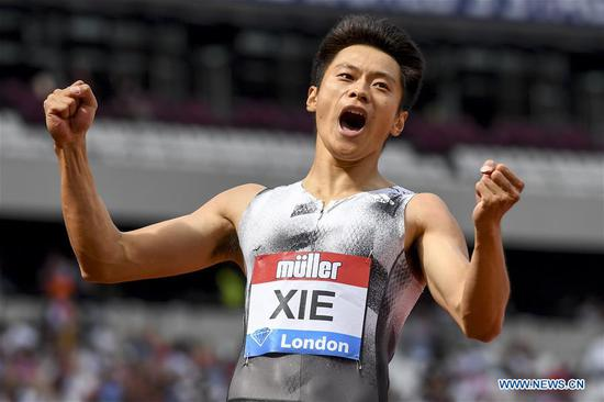 Xie Zhenye of China celebrates after the men's 200m final at Muller Anniversary Games at London Stadium in London, Britain, on July 21, 2019. (Xinhua/Alberto Pezzali)