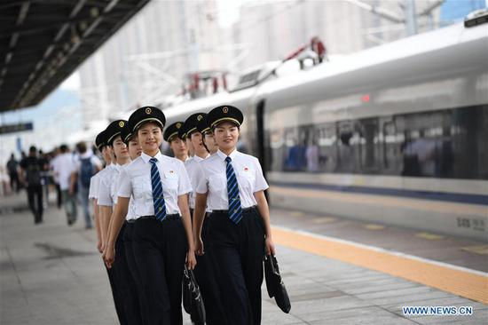 Trainees walk out of Baoji South Railway Station in Baoji, northwest China's Shaanxi Province, July 22, 2019. A total of 29 female trainees recently attended the training courses composed mainly of basic knowledge on high-speed railway as driving regulations and skills. Those who passed the training courses will become the first batch of female bullet train drivers in China. (Xinhua/Zhang Bowen)