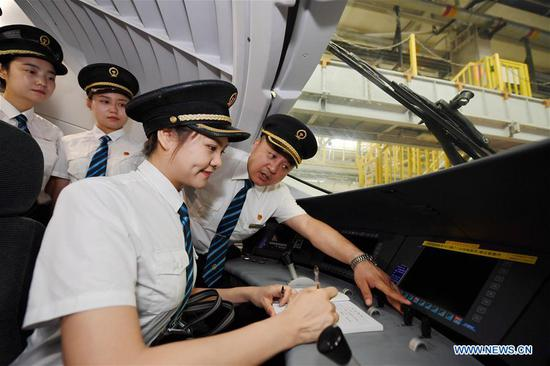 Trainees learn the bullet train driving skills in Xi'an, northwest China's Shaanxi Province, July 22, 2019. A total of 29 female trainees recently attended the training courses composed mainly of basic knowledge on high-speed railway as driving regulations and skills. Those who passed the training courses will become the first batch of female bullet train drivers in China. (Xinhua/Zhang Bowen)