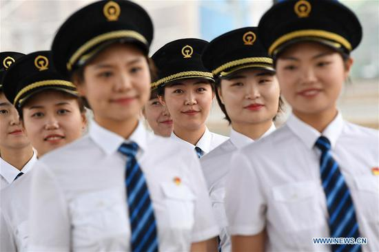 Trainees queue up to walk out of Baoji South Railway Station in Baoji, northwest China's Shaanxi Province, July 22, 2019. A total of 29 female trainees recently attended the training courses composed mainly of basic knowledge on high-speed railway as driving regulations and skills. Those who passed the training courses will become the first batch of female bullet train drivers in China. (Xinhua/Li Yibo)
