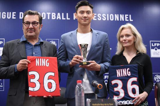 Ning Zetao (Center) is given two No.36 shirts from Ligue 1 clubs as he is appointed the Chinese ambassador of Ligue 1 in Shenzhen on Aug 2, 2019. [Photo: IC]