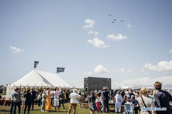 Photo provided by Goodwood shows guests watching the official start of the