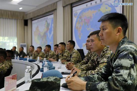 Personnel from the Chinese People's Armed Police Force and the National Guard of Kyrgyzstan attend a seminar in Urumqi, northwest China's Xinjiang Uygur Autonomous Region, Aug. 6, 2019. The China-Kyrgyzstan