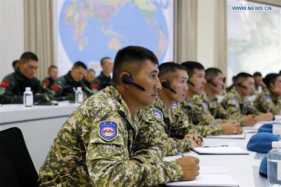 Personnel from the National Guard of Kyrgyzstan attend a seminar in Urumqi, northwest China's Xinjiang Uygur Autonomous Region, Aug. 6, 2019. The China-Kyrgyzstan