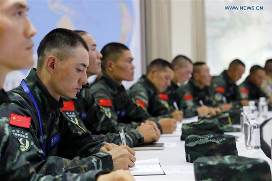 Personnel from the Chinese People's Armed Police Force attend a seminar in Urumqi, northwest China's Xinjiang Uygur Autonomous Region, Aug. 6, 2019. The China-Kyrgyzstan