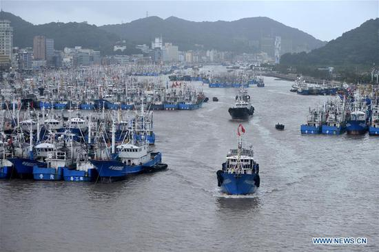 Photo taken on Aug. 8, 2019 shows ships returning to harbor in Zhoushan, east China's Zhejiang Province, Aug. 8, 2019. Provinces on the east coast of China have been busy getting prepared as Lekima, the ninth typhoon of the year, is moving northweastwards toward the mainland. (Photo by Hu Sheyou/Xinhua)