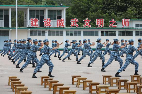 Students performes Yuejiaquan, a style of Chinese martial arts, at a graduation ceremony of the Hong Kong college students' military training camp on Sunday.