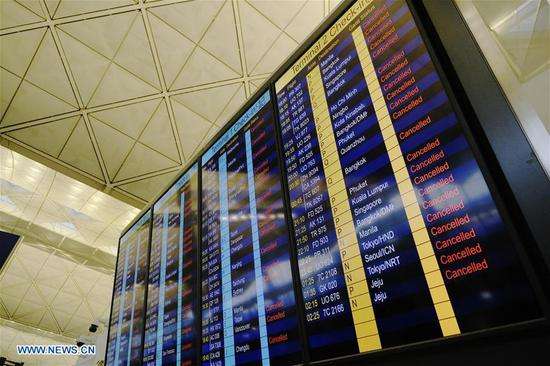 Cancelled flights are shown on a screen at Hong Kong International Airport in Hong Kong, south China, Aug. 12, 2019. All flights in and out of China's Hong Kong Special Administrative Region were cancelled on Monday due to a protest held in the Hong Kong International Airport, according to local airport authority. (Xinhua/Wang Shen)
