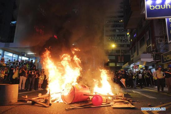 Violent radicals set fires after blocking a road in Causeway Bay, south China's Hong Kong, Aug. 4, 2019. Two months on, the escalating violence in Hong Kong has taken a heavy toll on the social order. Violent radicals committed acts of vandalism, blocked main traffic lanes, harassed urban commuters and set fires at will. Many have called for a brake to be put on the blatant violence and for order to be restored. (Xinhua)