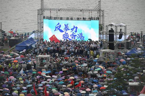 People from all walks of life take part in a rally to voice their opposition to violence and call for restoring social order, expressing the people's common will to protect and save the city at Tamar Park in south China's Hong Kong, Aug. 17, 2019. (Xinhua/Lui Siu Wai)