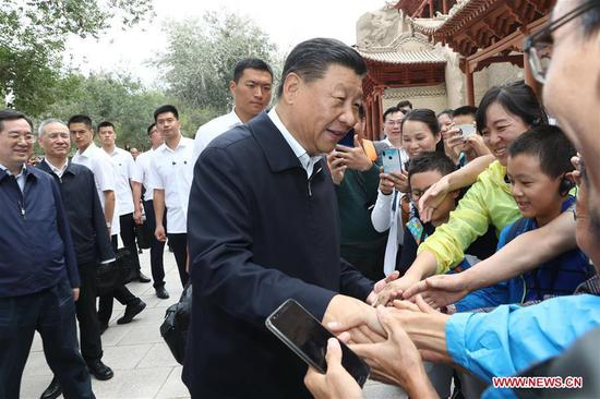 Chinese President Xi Jinping, also general secretary of the Communist Party of China (CPC) Central Committee and chairman of the Central Military Commission, visits the Mogao Grottoes in Dunhuang, a key cultural heritage site under state-level protection, during his inspection tour of northwest China's Gansu Province, Aug. 19, 2019. Xi inspected the work of cultural relics protection and study, as well as efforts to promote China's great history and fine culture. (Xinhua/Ju Peng)