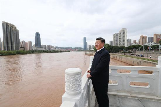 Chinese President Xi Jinping, also general secretary of the Communist Party of China Central Committee and chairman of the Central Military Commission, visits a Yellow River management point to learn about the management, protection and flood control project construction of the Yellow River in Lanzhou, northwest China's Gansu Province, Aug. 21, 2019. (Xinhua/Ju Peng)