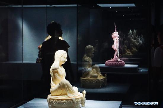 Photo taken on Aug. 22, 2019 shows porcelain statues displayed during an exhibition of Dehua porcelain held at Prince Kung's Mansion in Beijing, capital of China. About 80 items of Dehua porcelain artworks made by artisans in southeast China's Fujian Province featuring Tibetan Buddhist statues in the Ming and Qing Dynasties (1368-1911) were on display during the ten-day exhibition, which kicked off here Thursday. Dehua porcelain is a type of white Chinese porcelain made in Dehua County of Fujian Province. Dehua is celebrated for its white porcelain, especially statues, such as those of Buddha. (Xinhua/Cui Bowen)