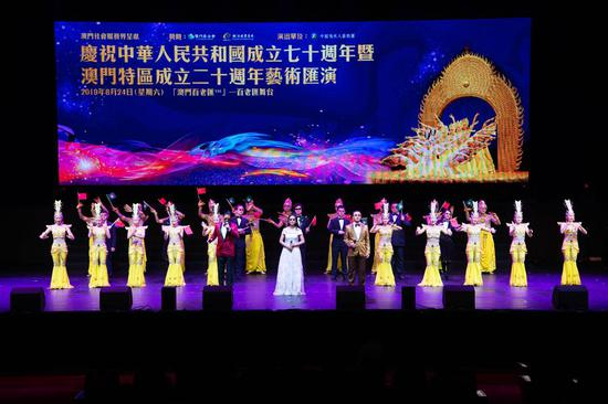 Artists from China Disabled People's Performing Art Troupe sing to celebrate the 70th anniversary of the founding of the People's Republic of China and the 20th anniversary of Macao's return to the motherland, in south China's Macao, Aug. 24, 2019. (Xinhua/Cheong Kam Ka)