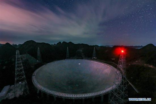 Photo taken on Aug. 27, 2019 shows China's Five-hundred-meter Aperture Spherical radio Telescope (FAST) in southwest China's Guizhou Province. China's FAST, the world's largest single-dish radio telescope, will greet the third anniversary of operation that began in September 2016. (Xinhua/Ou Dongqu)