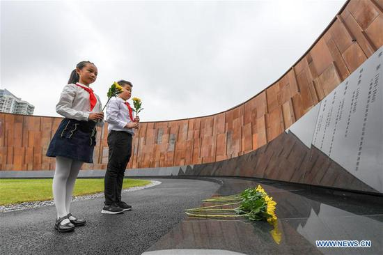 Student representatives lay flowers for Nanjing Massacre victims at the Memorial Hall of the Victims in Nanjing Massacre by Japanese Invaders in Nanjing, east China's Jiangsu Province, Sept. 3, 2019. Activities were held Tuesday in Nanjing to commemorate the 74th anniversary of the victory in the Chinese People's War of Resistance Against Japanese Aggression and the World Anti-Fascist War. (Xinhua/Li Bo)