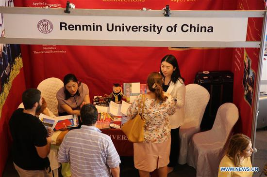 "Tunisian students consult representatives from Renmin University of China on studying information at the exhibition of ""China Campus 2019"" in Tunis, Tunisia, on Sept. 3, 2019. Chinese universities enjoy high quality education and facilities, which could attract more Tunisian students to study in China, Tunisian Minister of Higher Education and Scientific Research Slim Khalbous said Tuesday. (Photo by Adele Ezzine/Xinhua)"
