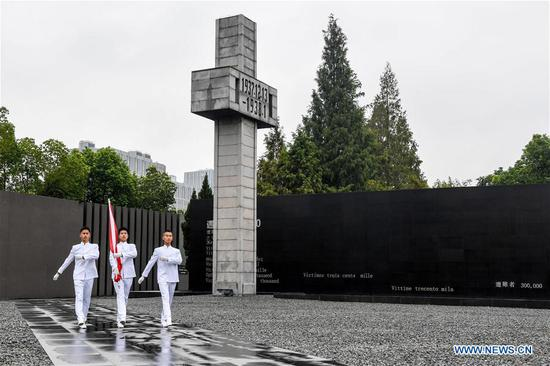 A flag-raising ceremony is held at the Memorial Hall of the Victims in Nanjing Massacre by Japanese Invaders in Nanjing, east China's Jiangsu Province, Sept. 3, 2019. Activities were held Tuesday in Nanjing to commemorate the 74th anniversary of the victory in the Chinese People's War of Resistance Against Japanese Aggression and the World Anti-Fascist War. (Xinhua/Li Bo)
