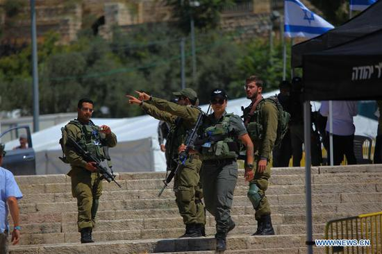 Israeli soldiers stand guard during the visit of Israeli Prime Minister Benjamin Netanyahu in the West Bank city of Hebron, on Sept. 4, 2019. Israeli Prime Minister Benjamin Netanyahu on Wednesday made a controversial visit to a flashpoint site in the West Bank city of Hebron to mark the killing of Jews there in 1929. (Photo by Mamoun Wazwaz/Xinhua)
