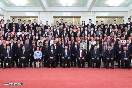 Chinese President Xi Jinping, also general secretary of the Communist Party of China (CPC) Central Committee and chairman of the Central Military Commission, meets with representatives of outstanding units and individuals in education circles at the Great Hall of the People in Beijing, capital of China, Sept. 10, 2019, extending Teachers' Day greetings to teachers and workers in education circles across the country. Also present were Premier Li Keqiang and Wang Huning, a member of the Secretariat of the CPC Central Committee, both of whom are members of the Standing Committee of the Political Bureau of the CPC Central Committee. (Xinhua/Ju Peng)