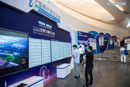 People visit a products exhibition during the 2019 World Computer Congress in Changsha, central China's Hunan Province, Sept. 10, 2019. The 2019 World Computer Congress kicked off here on Tuesday. (Xinhua/Chen Sihan)