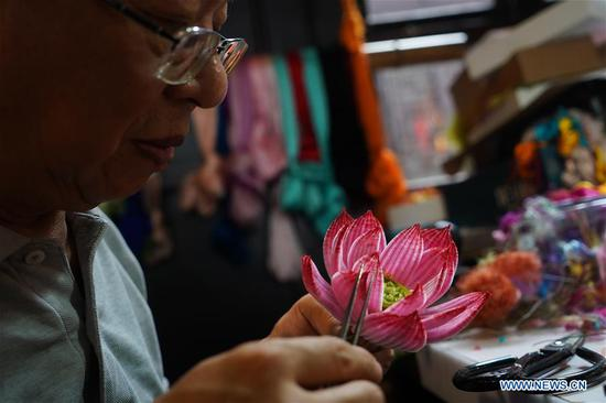 Zhao Shuxian works on a velvet flower handicraft at the workshop of Nanjing Intangible Cultural Heritage Exhibition Center in Nanjing, capital of east China's Jiangsu Province, Sept. 14, 2019. Zhao Shuxian, 65, a representative inheritor of the