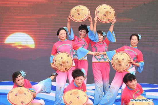 Villagers perform during a celebration marking the launching of a fishing season at Tongzhao Village in Fenghua District of Ningbo City, east China's Zhejiang Province, Sept. 15, 2019. A celebration marking the launching of a fishing season was held here to pray for good luck. The annual summer fishing ban on the East China Sea will end on Sept. 16. (Xinhua/Huang Zongzhi)