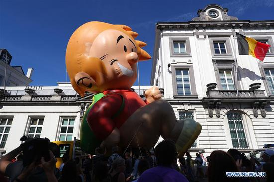 People attend the Balloon's Day Parade of the 2019 Brussels Comic Strip Festival in Brussels, Belgium, Sept. 15, 2019. The Balloon's Day Parade is a traditional show during each year's comic festival. (Xinhua/Zheng Huansong)