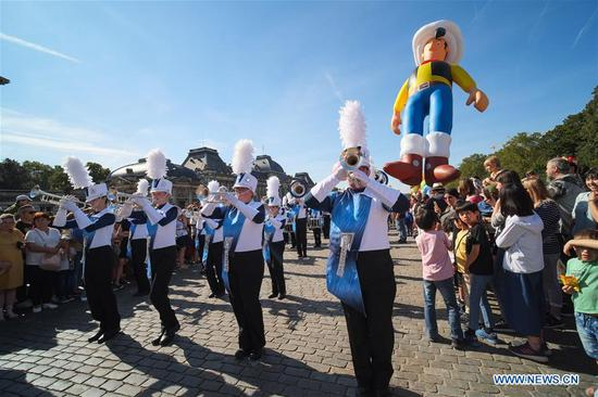 People attend the Balloon's Day Parade of the 2019 Brussels Comic Strip Festival in Brussels, Belgium, Sept. 15, 2019. The Balloon's Day Parade is a traditional show during each year's comic festival. (Xinhua/Zhang Cheng)