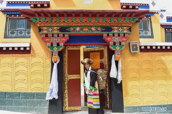 Villager Purbu Zhoima prepares to move into her new house in Lhozhag Town of Lhozhag County, Shannan City, southwest China's Tibet Autonomous Region, Sept. 21, 2019. A total of 88 villagers from 28 households moved to their new two-story dwellings to improve housing conditions. (Xinhua/Jigme Dorje)