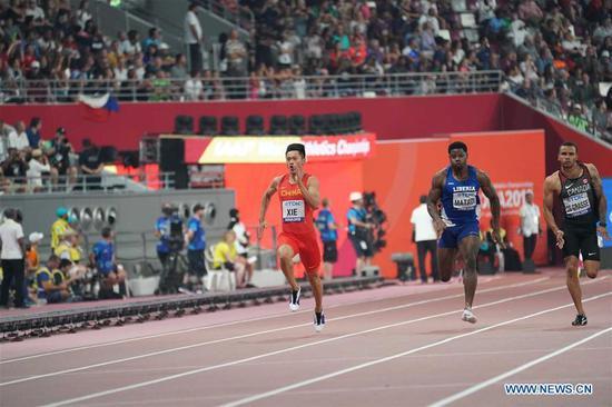 Xie Zhenye (L) of China competes during the men's 100m semi-final at the 2019 IAAF World Athletics Championships in Doha, Qatar, on Sept. 28, 2019. (Xinhua/Li Gang)