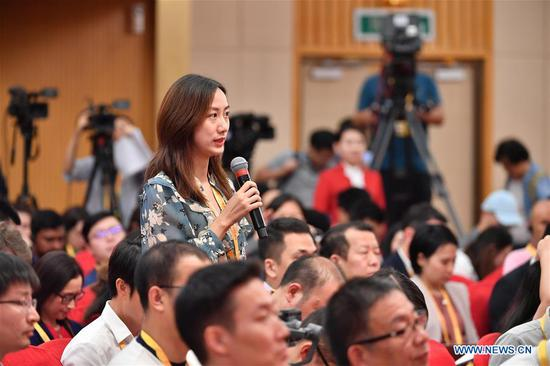 A reporter asks questions during a press conference in Beijing, capital of China, Sept. 29, 2019. The press center for the celebration of the 70th anniversary of the founding of the People's Republic of China held a press conference on Sunday on China's efforts to advance opening-up to a higher level and promote high-quality development of commerce. (Xinhua/Li Xin)
