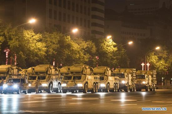 Vehicles to be reviewed in the military parade marking the 70th anniversary of the founding of the People's Republic of China (PRC) arrive at Dongdan area in Beijing, capital of China, Oct. 1, 2019. (Xinhua/Zhang Haofu)