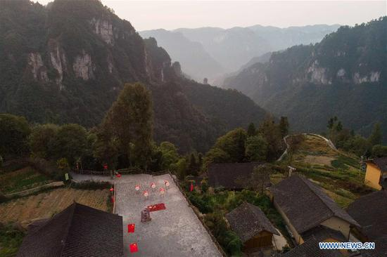Aerial photo taken on Oct. 1, 2019 shows the morning scenery in Shibadong Village, Xiangxi Tujia and Miao Autonomous Prefecture in central China's Hunan Province. Celebrations for the 70th anniversary of the founding of the People's Republic of China (PRC) will be held Tuesday in central Beijing. (Xinhua/Chen Sihan)