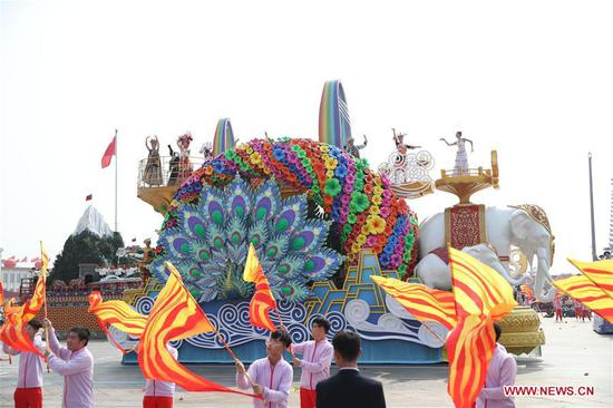 A float representing Yunnan Province takes part in a mass pageantry celebrating the 70th anniversary of the founding of the People's Republic of China (PRC) in Beijing, capital of China, Oct. 1, 2019. (Xinhua/Meng Yongmin)