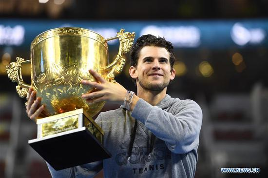 Dominic Thiem of Austria holds up the trophy during the awarding ceremony after the men's singles final match against Stefanos Tsitsipas of Greece at 2019 China Open tennis tournament in Beijing, capital of China, Oct. 6, 2019. (Xinhua/Zhang Hongxiang)