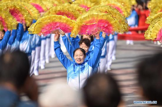 Elderly people perform to celebrate Chongyang festival in Dingzhou, north China's Hebei Province, Oct. 7, 2019. Nearly 1,000 elderly people perform on Monday to celebrate the Chongyang Festival. The Chongyang Festival, which falls on the ninth day of the ninth Chinese lunar month, is a day to pay respect to seniors in China. (Xinhua/Zhu Xudong)