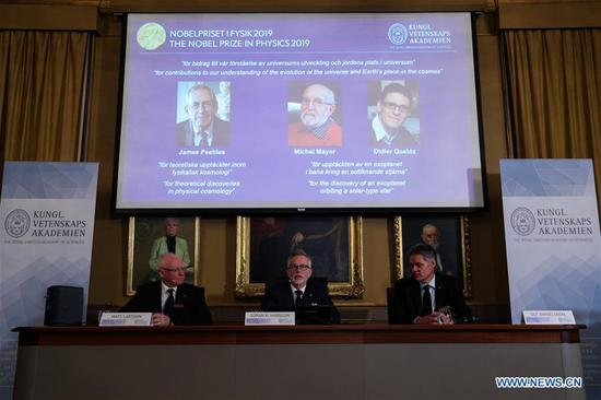 Photo taken on Oct. 8, 2019 shows the announcement of the 2019 Nobel Prize in Physics in Stockholm, Sweden. The 2019 Nobel Prize in Physics are shared by three scientists, the Royal Academy of Sciences in Stockholm announced on Tuesday. (Xinhua/Zheng Huansong)