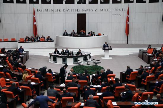 Turkish parliament members vote for a motion to extend the government's authority to launch cross-border military operations in Iraq and Syria, in Ankara, Turkey, on Oct. 8, 2019. Turkish parliament on Tuesday extended a motion for the government's authority to launch cross-border military operations in Iraq and Syria for one more year. (Photo by Mustafa Kaya/Xinhua)