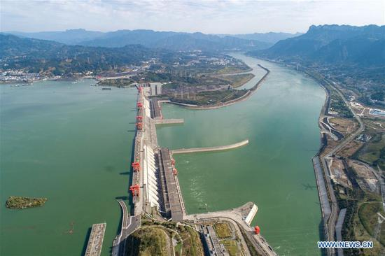 Aerial photo taken on Oct. 28, 2019 shows the view of the Three Gorges project in Zigui County, central China's Hubei Province. The 175-meter experimental impoundment of Three Gorges this year came to the end at present as the water level of the Three Gorges Reservoir rose to 174.43 meters as of 8pm Monday. (Photo by Wang Gang/Xinhua)